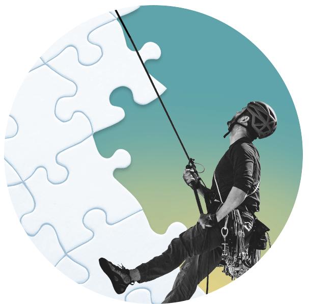A climber climbing amongst puzzle pieces
